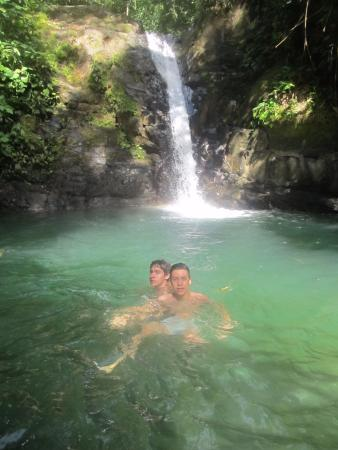 Uvita Waterfall: My teens after the challenging hike between boulders.