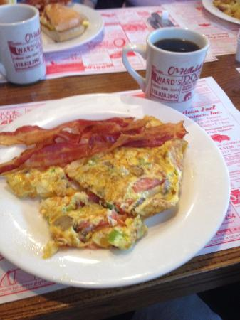 Hillsdale, NY: 3 egg omelette with cheddar, mushrooms, tomatoes and onions. Side of bacon