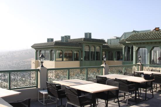 Palais Faraj Suites & Spa: This is a patio outside of the breakfast area. Beautiful in the morning