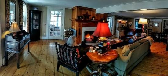 Dorset, VT: Relaxing by the fire in the living room.