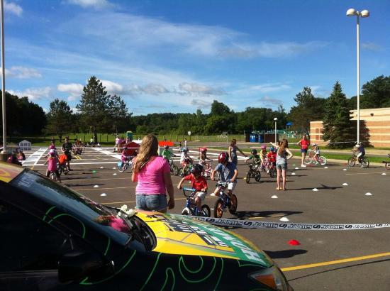 Brighton, MI: Hometown Bicycles teaching kids bicycle safety training at a local elementary school