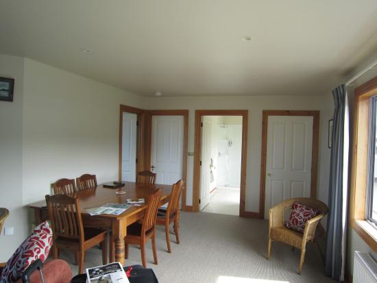 Kaka Point, New Zealand: living room and dining table