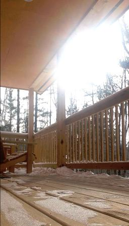 Jeffersonville, VT: outdoor porch with 2 beautiful adirondack chairs