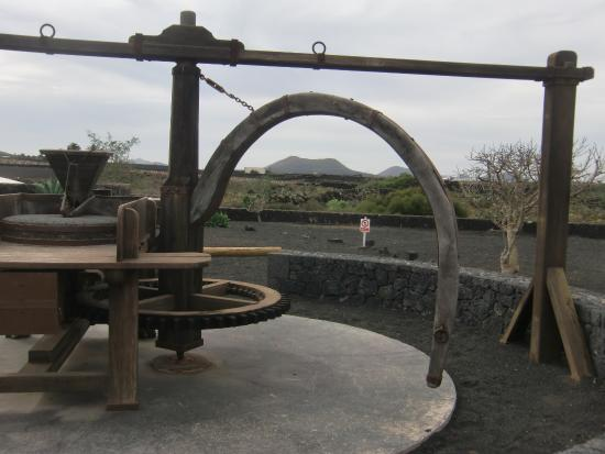 San Bartolome, Spain: A mill exhibit located to the right outside the shop area