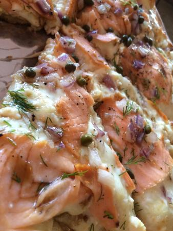 Vandalia, OH: Garlic Olive Oil, Mozzarella- Provolone & Feta Cheese, Red Onions, Smoked Salmon. Topped with Fr