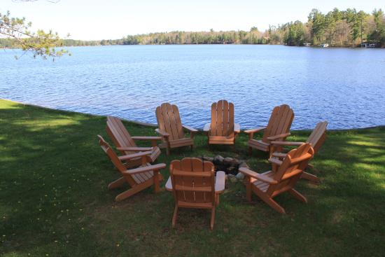 Manitowish Waters, WI: Private campfire pit with Adirondack chairs.