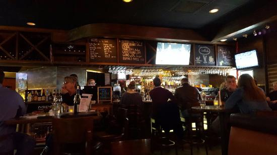 Katy, TX: View toward the bar. The beer names are written on the board