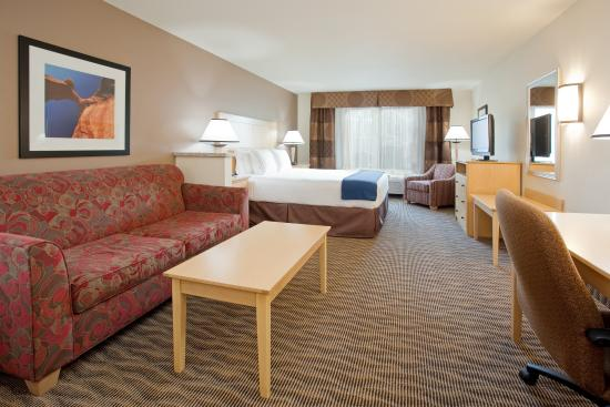 West Valley City, UT: King Bed Suite with artwork of local majestic landscape