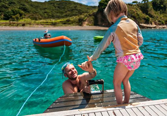 Paihia, New Zealand: my daughter about to jump in and swim to shore