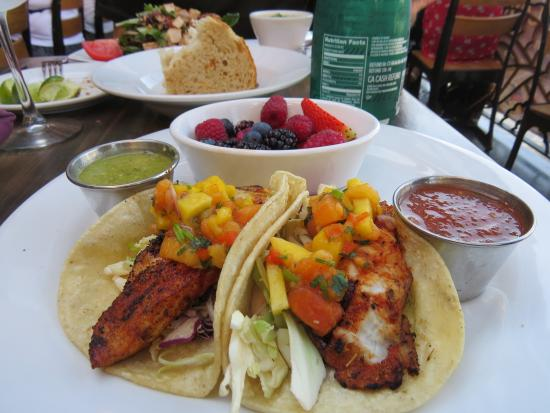 Blackened fish tacos with a side of fresh fruit picture for Rock n fish manhattan beach
