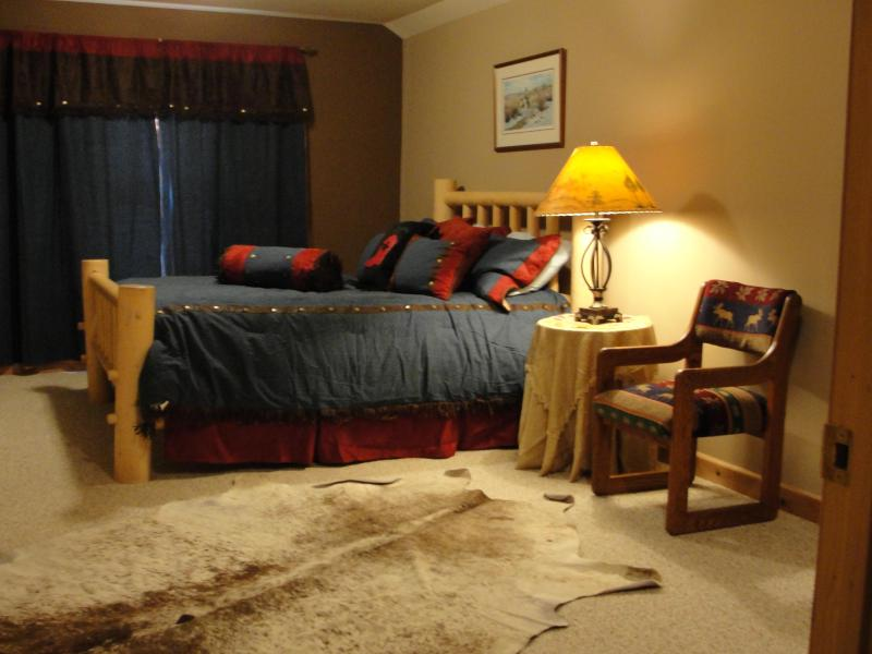 Western decor decorates this large one bedroom apartment with desk and walk-in closet