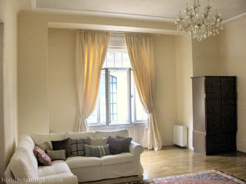 The sitting room which is spacious and elegant with parquet floor, old chandelier,  Turkish rugs