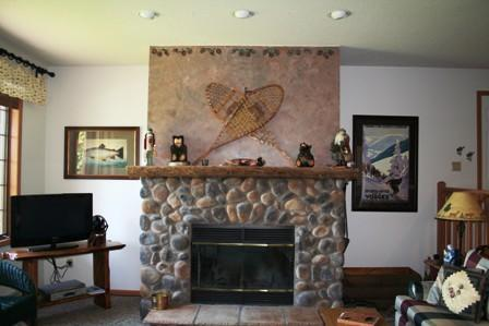 Living area with stone fireplace-wonderful lake and mountain views;