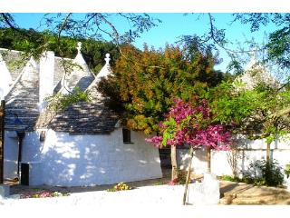 Charming renovated group of trulli, set in the hills of vineyards and Mediterranean maquis.