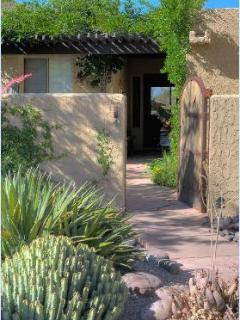 A mesquite gate and wisteria-covered ramada welcome you to your Tucson hideaway