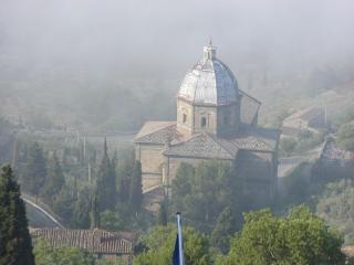View of the Church of Santa Maria del Calcinaio from the upstairs balcony in morning fog