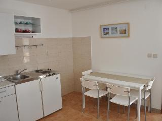 Appartment Radolovic A1, romantic with pool&garden