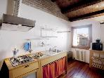 A bright and charming apartment with a stunning view of the San Giorgio dei Greci Church
