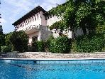 Lake Maggiore waterfront villa with dock and pool