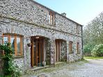 MORESDALE BANK COTTAGE, stone built cottage, with three bedrooms, woodburning stove, and garden, in Greyrigg, Ref 14694