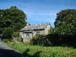 Woodland Cottage on its own in farmland, Cartmel