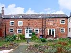 THE DAIRY, family friendly, character holiday cottage, with a garden in Rossett, Ref 1335