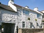 KINGSLOW COTTAGE, pet friendly, with a garden in Newborough, Ref 11166
