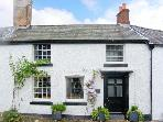 DARWIN COTTAGE, pet friendly, character holiday cottage, with open fire in Llansilin, Ref 11215