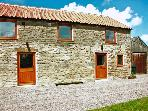 STABLE COTTAGE, pet friendly, character holiday cottage, with a garden in Levisham, Ref 1136