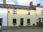 SAFFRON COTTAGE, pet friendly, luxury holiday cottage, with open fire in Flookburgh, Ref 11718