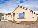 SHIANTS, a single storey cottage, with two bedrooms, sitting room and sun room, in Broadford, Ref 11850