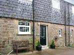 SHEPHERDS NOOK, family friendly, character holiday cottage, with a garden in North Charlton, Ref 1362
