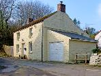 STAR MILL COTTAGE, detached cottage, woodburner, alongside stream near Cardigan, Ref: 13722