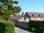 LLYS Y WENNOL, ground floor character cottage, with open plan living area, and enclosed garden, in Rowen, Ref 15696