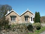 PABO LODGE, pet friendly, character holiday cottage, with a garden in Llandudno, Ref 1719