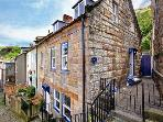 GRIMES COTTAGE, Grade II listed cottage, woodburning stove, sunny rear courtyard, close to beach, in Staithes, Ref 18478