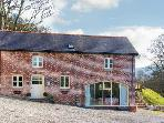 TY IFA, luxury cottage, en-suite facilities, pet friendly, farmhouse kitchen, large garden, near Llangollen, Ref 21229
