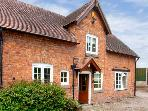 STABLE COTTAGE, family friendly, character holiday cottage, with a garden in Tilston, Ref 5480