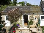 THE OLD DAIRY AT SHAWS FARM, pet friendly, country holiday cottage, with a garden in Atlow, Ref 6878
