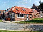 RABBIT HOUSE, pet friendly, luxury holiday cottage, with a garden in Skipsea, Ref 8242