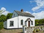 BOB&#39;S COTTAGE, pet friendly, with a garden in Duncannon, County Wexford, Ref 8421