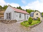 THE DISPENSARY, detached bungalow, en-suite bedroom, pet friendly, in Killeagh, Ref 16695