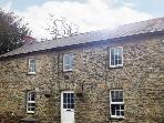 CAPEL IAGO, detached pet-friendly cottage, woodburner, open fire, garden, walks and cycling, near Llanybydder, Ref 20608