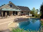 Great amenities---close to town, pool, dock, hot tub!