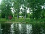 Beautiful Lakefront Property with Beach and Boat.
