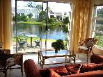 Peaceful waterside cottage for 2 in Marina da Gama