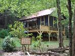 Schoolhouse ~2 bed/1 bath~Sleeps 6~Hot tub~River Front~WIFI~Gas logs~Firepit~Charcoal Grill~Pet Friendly~Only $99/night