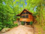 One bedroom log cabin sleeps 4 in Smoky Mountains area.