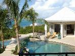 Luxury 4 bedroom Providenciales villa. Beachfront! Large infinity-edge pool!