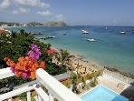 OUALIE PENTHOUSE... contemporary beachfront condo on Grand Case beach, walk to 35+ great restaurants and shops!